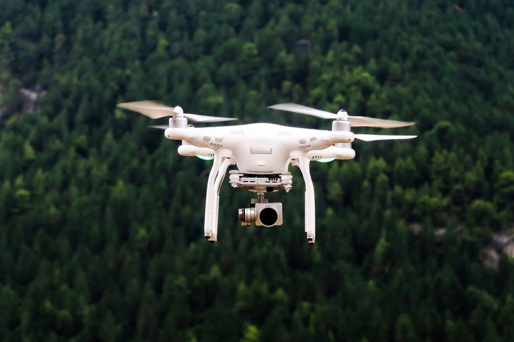 Flying white drone. Photo.